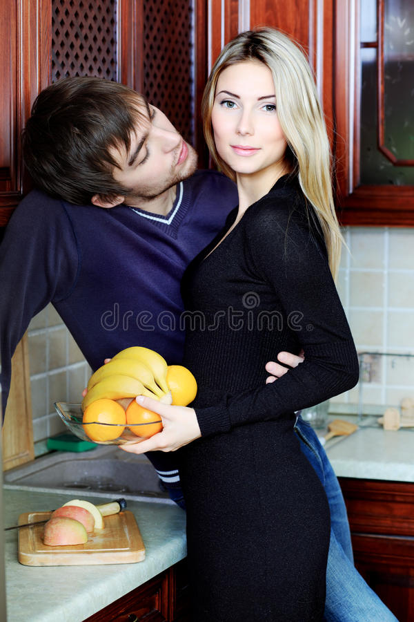Couple at a kitchen stock photography