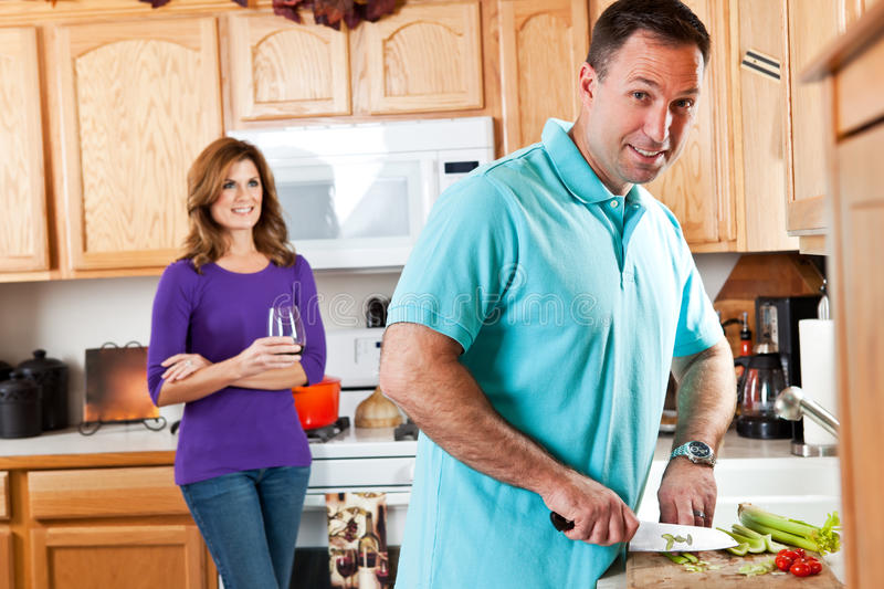 Couple in kitchen royalty free stock images