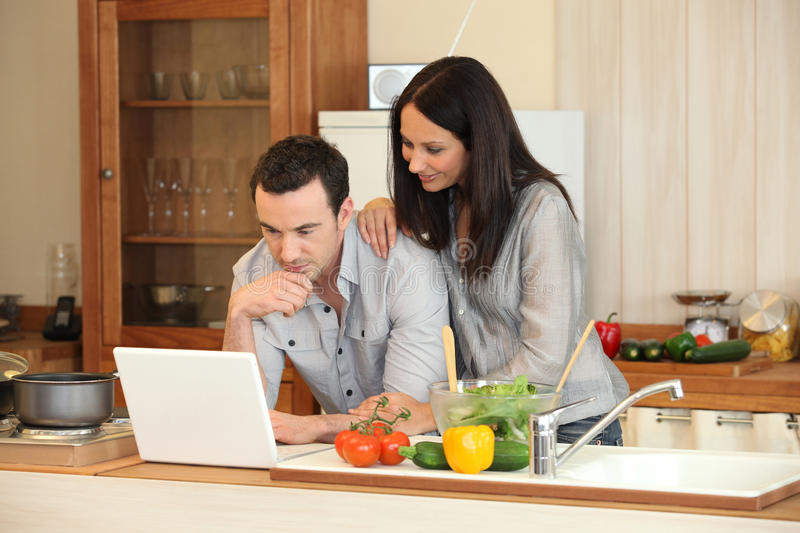 Download Couple in a kitchen stock image. Image of persons, cutting - 18171543