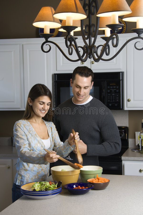 Couple in kitchen. royalty free stock image