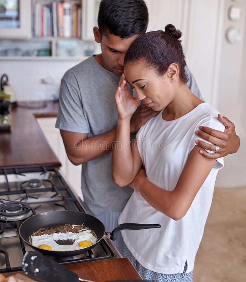Couple kitchen affection royalty free stock image