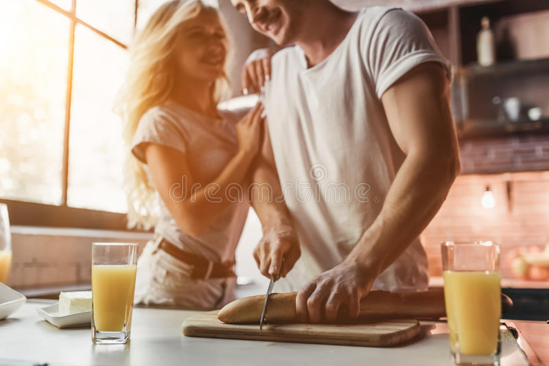 Couple on kitchen royalty free stock images