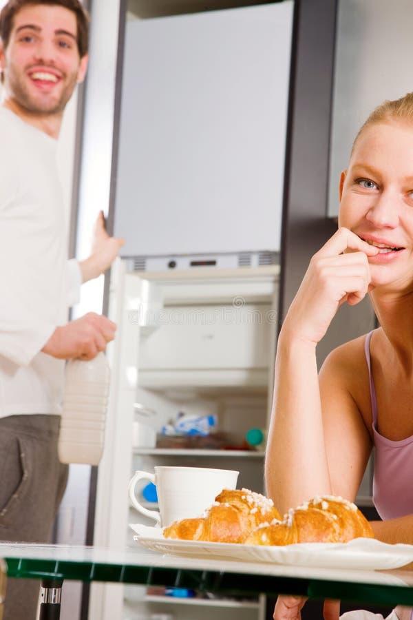 Couple In Kitchen Having Breakfast Stock Images