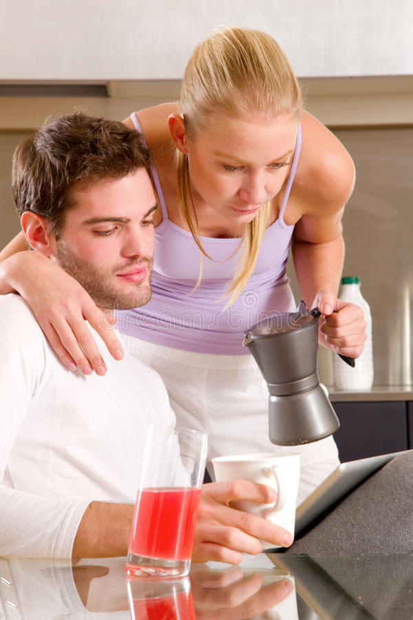 Couple in kitchen having breakfast royalty free stock images