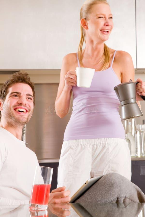 Couple in kitchen having breakfast stock photos