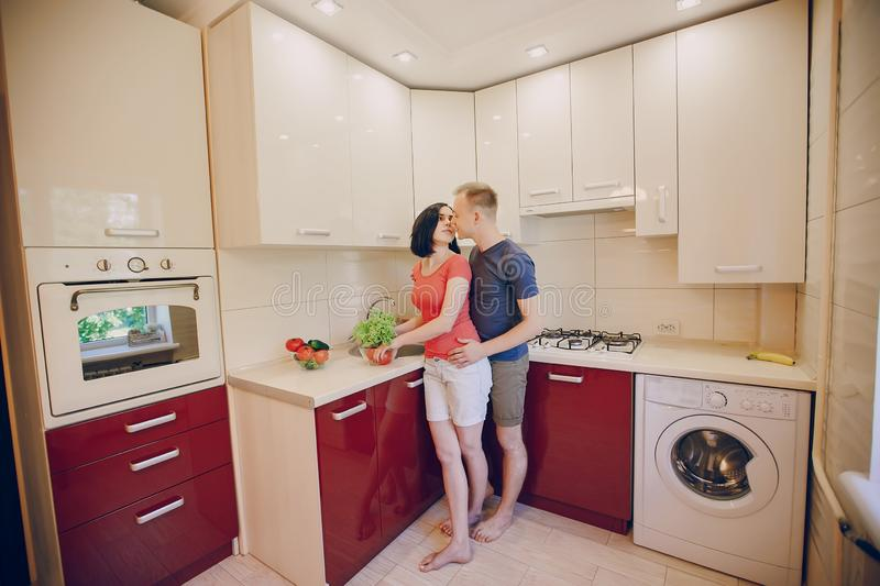 Couple in a kitchen royalty free stock photography