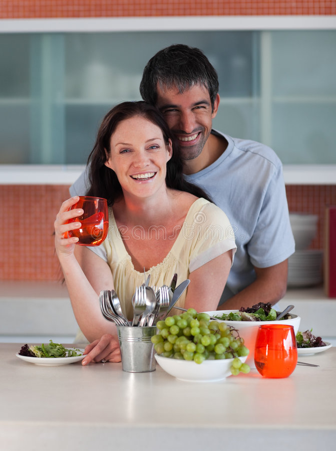 Couple in Kitchen smiling at camera stock photos