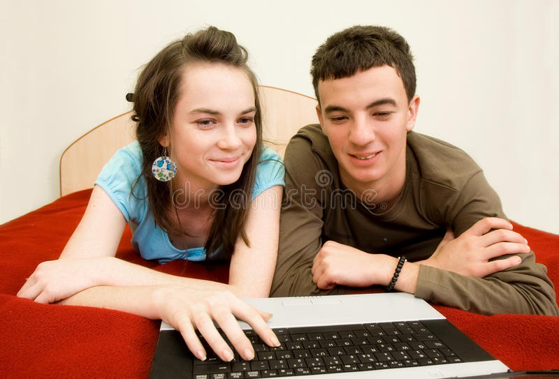 Download Couple with laptop stock photo. Image of messenger, computer - 12213370
