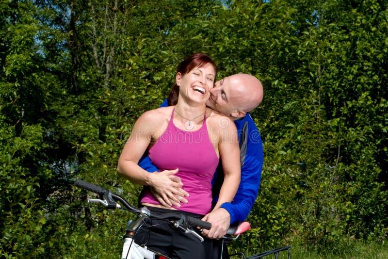Download Couple Laughing Next To Bike - Horizontal Stock Photo - Image: 5842204