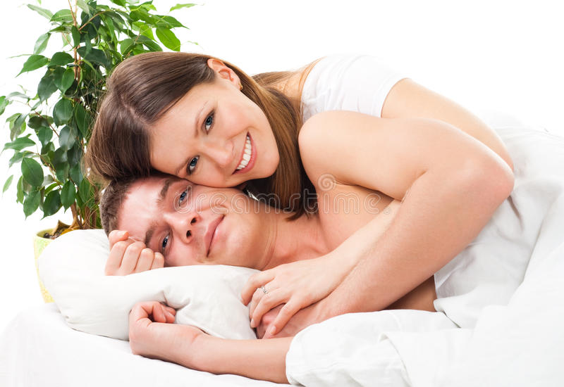 Couple lay in the bed and and smile stock photo