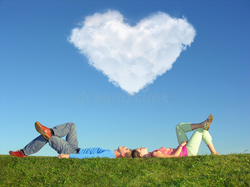 Download The Couple Lays On Grass Stock Photos - Image: 5281753
