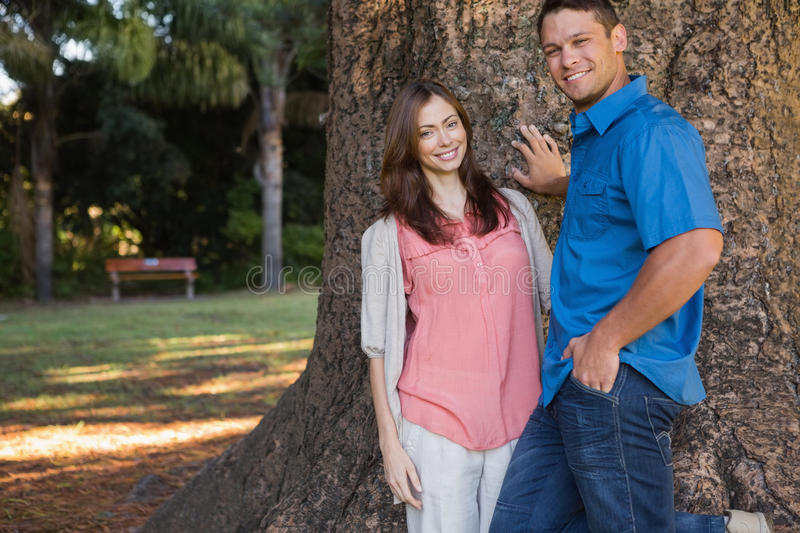 Download Couple leaning on a tree stock image. Image of short - 32514823