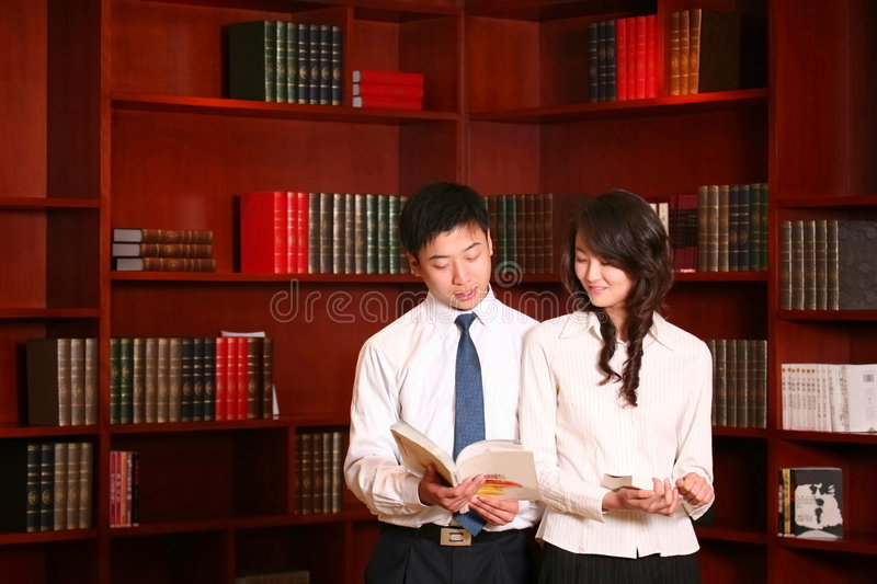 Couple In the library stock images