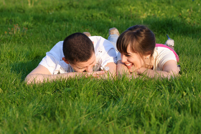 Download Couple Lie On The Grass Stock Photos - Image: 16221993