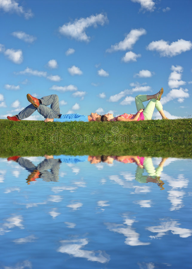 Free Couple Lies Under Clouds Stock Images - 1182984