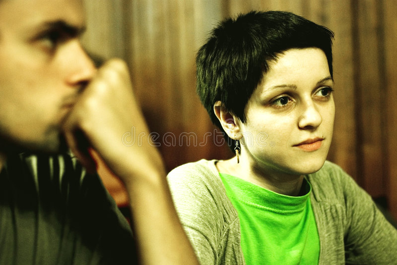 Couple listening to friends stock photography