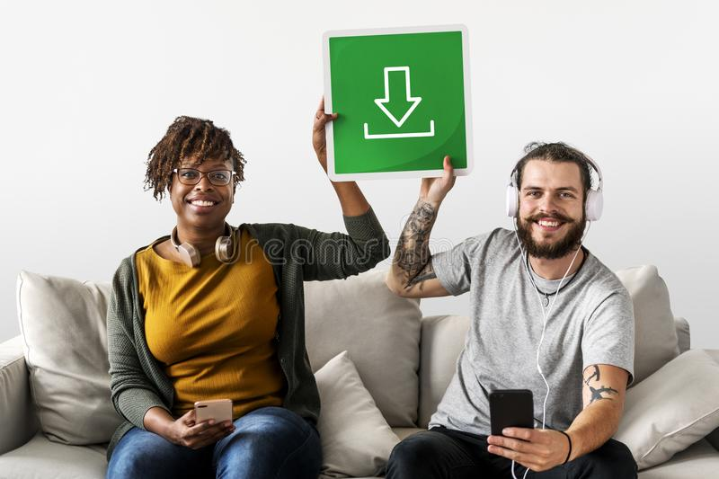 Couple listening to music and holding signs stock image