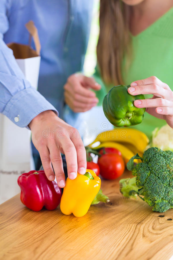 Couple living healthy eating fruits and vegetables. Man and women living vegetarian and healthy by eating fruits and vegetables stock images