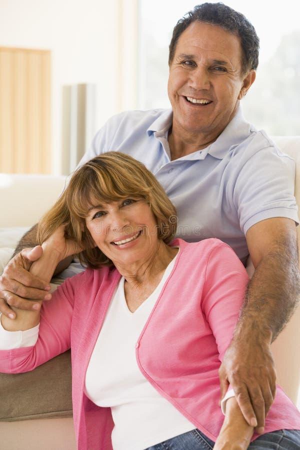 couple living relaxing room smiling στοκ εικόνες
