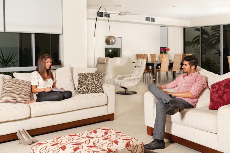 Couple in living room stock photos