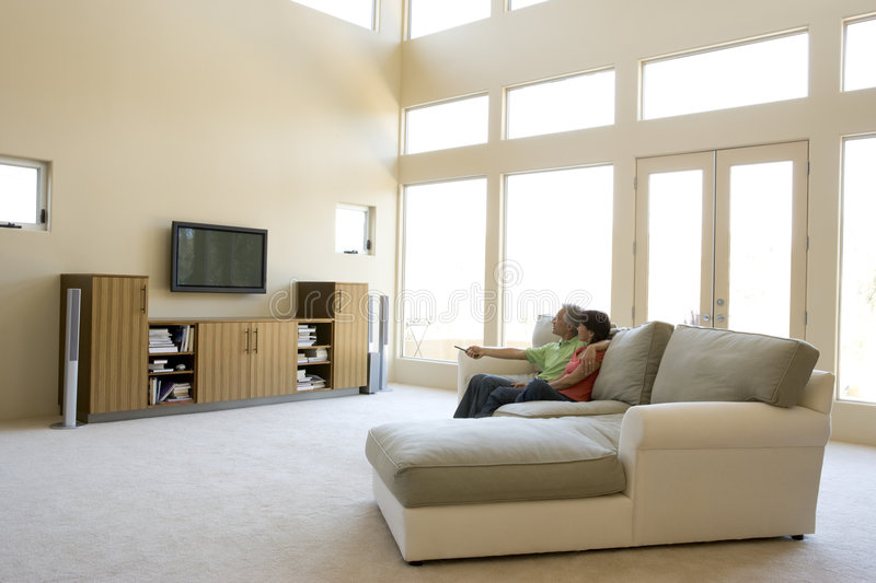 Download Couple In Living Room Watching Television Stock Image - Image: 5687415