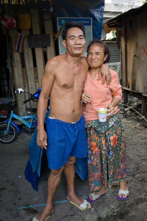 A couple living in a slum doing laundry royalty free stock image