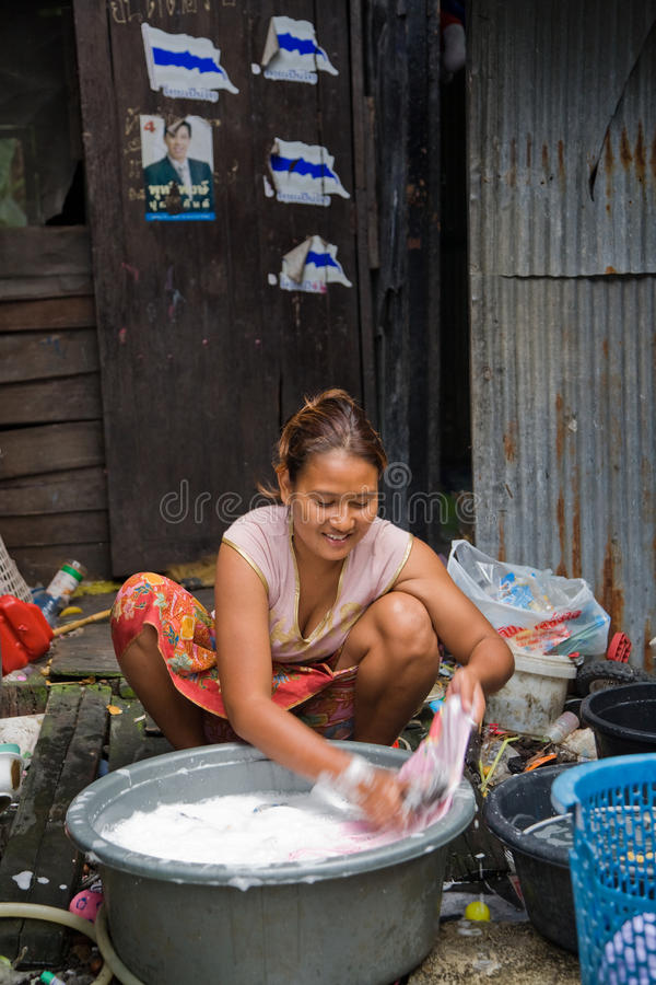 A couple living in a slum doing laundry royalty free stock photo