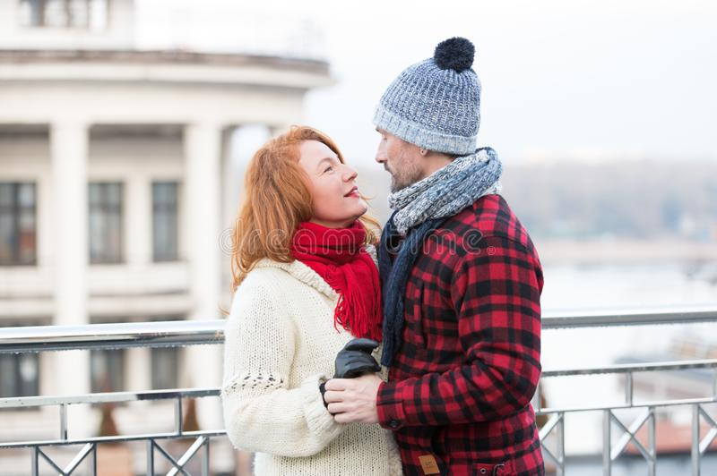 Couple look into eyes each other. Happy couple looking eyes to eyes. Smiling woman looks to happy man. Face to face date. Couple look into eyes each other. Happy royalty free stock images