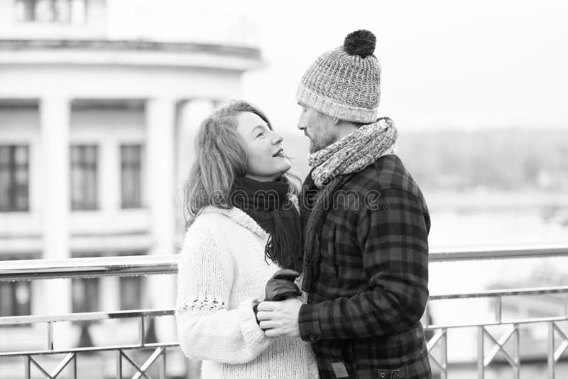 Couple look into eyes each other. Happy couple looking eyes to eyes. Smiling woman looks to happy man when dancing on street. royalty free stock photo
