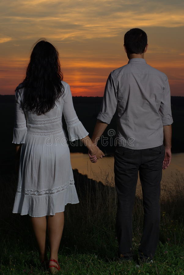 Free Couple Looking At The Sunset And Lake Royalty Free Stock Images - 35301229