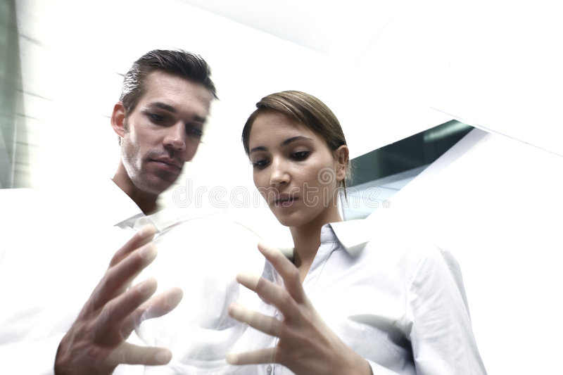 Download Couple looking at ball stock photo. Image of holding, woman - 5694052