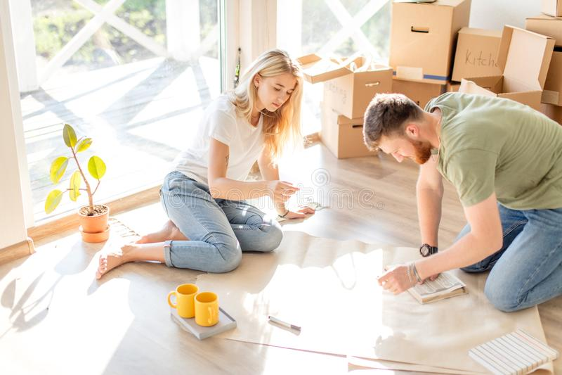 Couple looking blueprints of they new house. Planning interior design stock images