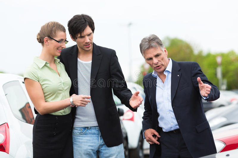 Download Couple Looking At Car On Yard Of Dealer Stock Image - Image of happy, mature: 25407407