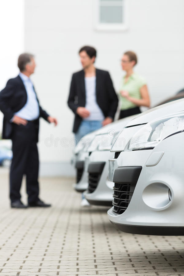 Download Couple Looking At Car On Yard Of Dealer Stock Image - Image of sales, looking: 26622443