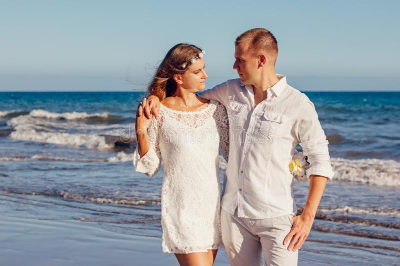 Couple Looking at Each Other Beside Beach stock photo
