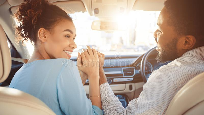 Couple looking at each other in car royalty free stock image