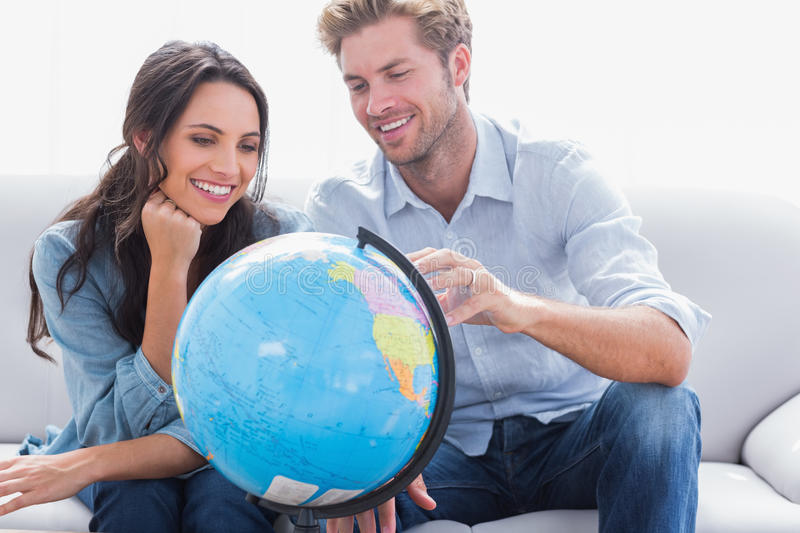 Couple looking at a globe royalty free stock photo
