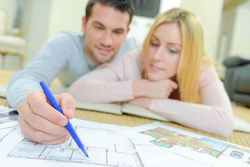 Couple looking at house plans stock image
