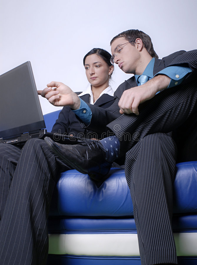 Download Couple looking at laptop stock image. Image of collaborating - 2481447