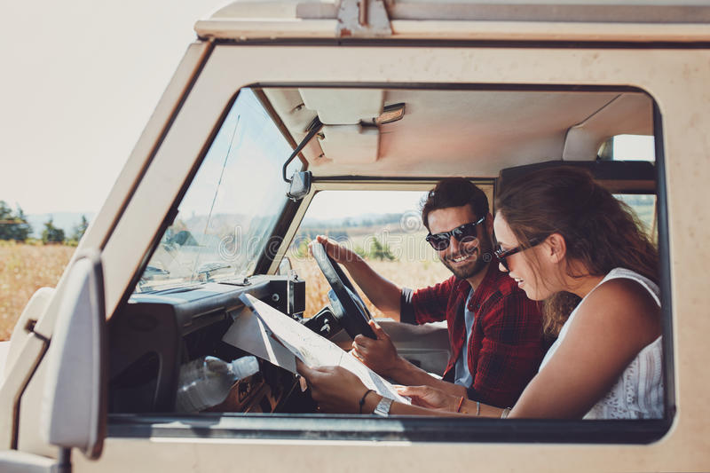 Couple looking at the map in their car royalty free stock photography