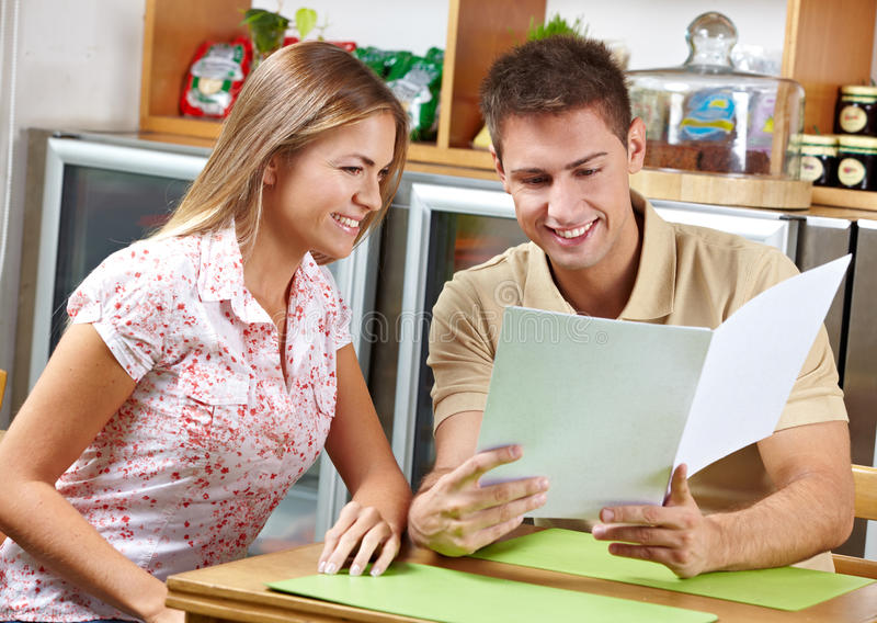 Download Couple looking at menu stock photo. Image of lunch, relationship - 25633412