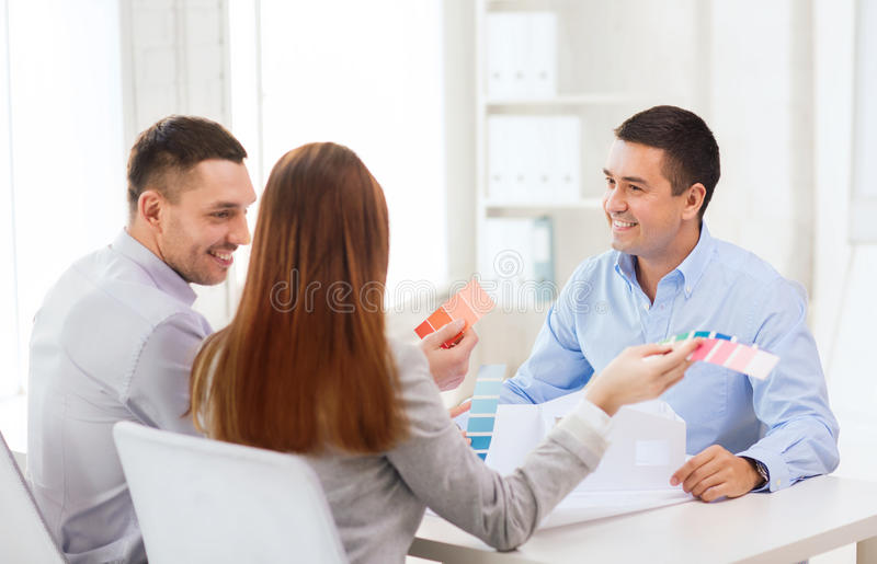 Couple looking at model of their house at office stock images