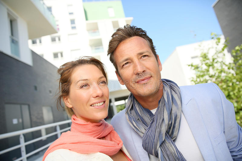 Couple looking for new appartement to buy in residential area. Couple looking for new apartment stock photos