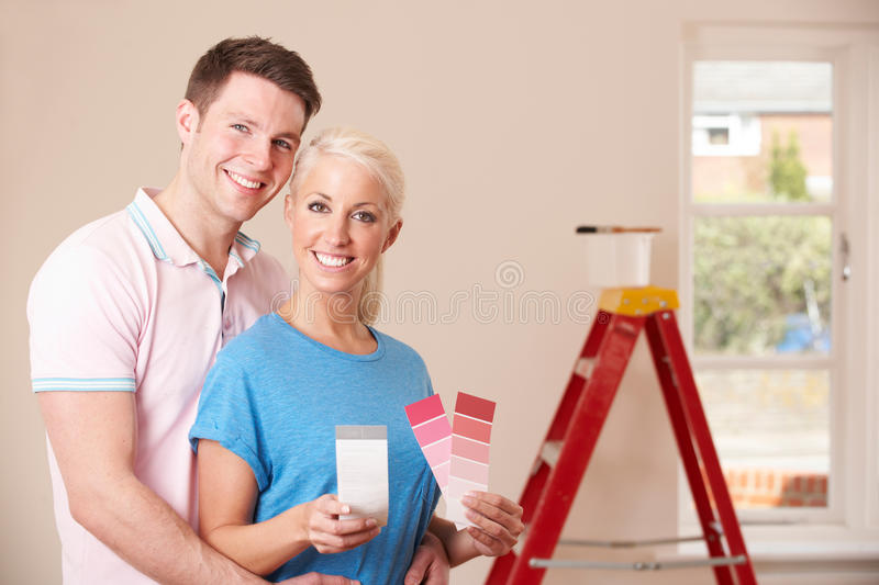 Couple Looking At Paint Swatches Together. Couple Look At Paint Swatches Together stock photography