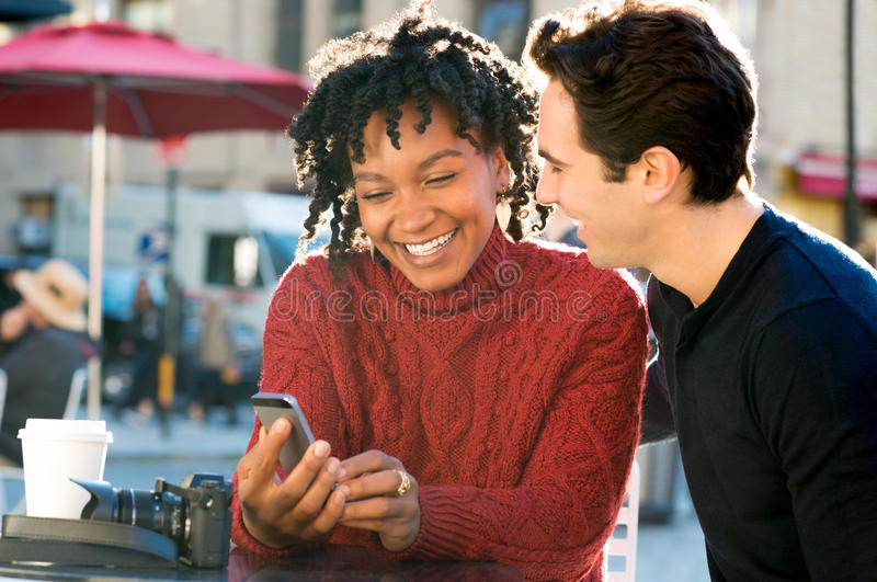 Couple looking at phone outdoor royalty free stock image