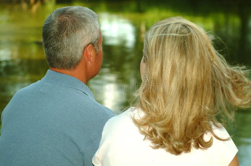 Download Couple Looking at Pond stock image. Image of married, lady - 110523