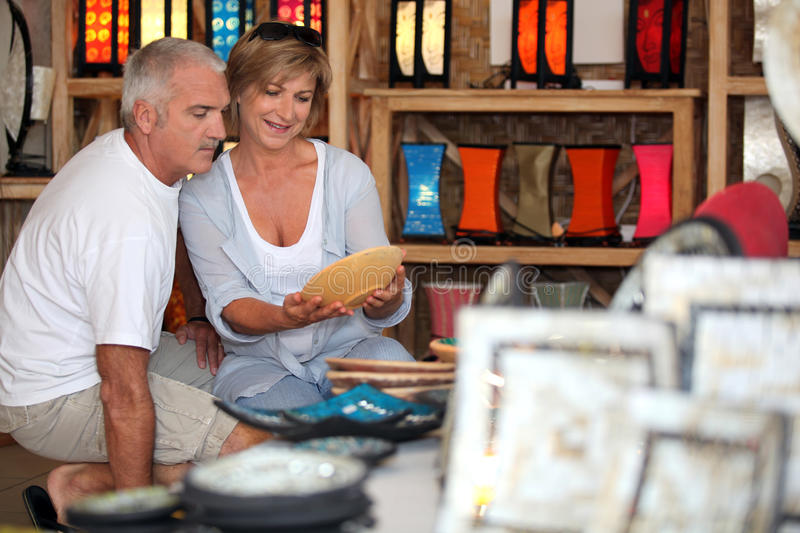Couple looking pottery on holiday. Couple looking at local pottery on holiday stock images
