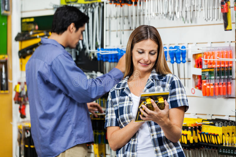 Couple Looking At Product's In Hardware Store royalty free stock photo