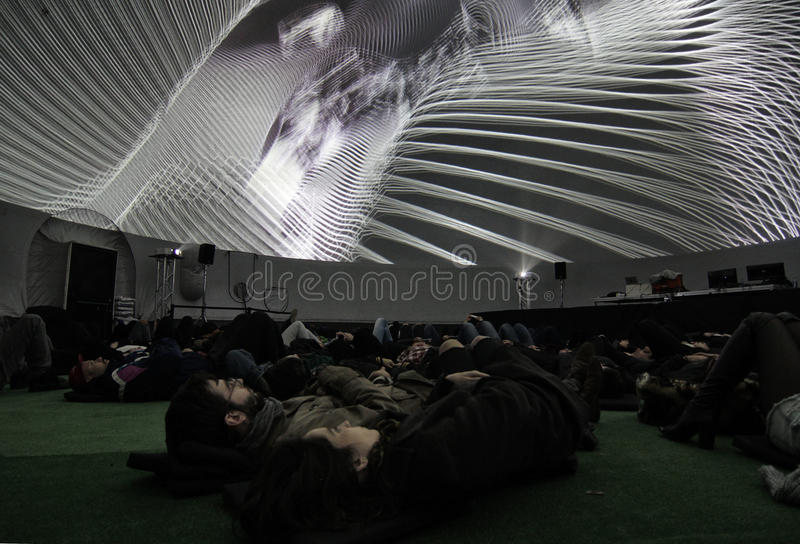 Couple looking at a projection in a Fulldome. stock image