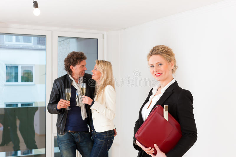 Couple looking for real estate with female realtor. Real estate market - young couple looking for real estate to rent or buy an apartment royalty free stock images